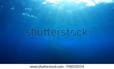 Underwater blue background in ocean #748010554