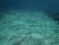 Underwater cables on the ocean floor in the Mediterranean Sea.