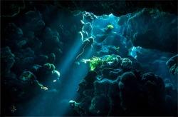 Underwater cave sunbeam scene. Fantasy rocks under water