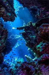 Underwater deep rock pass in depth. Underwater cave entrance. Underwater depth scene