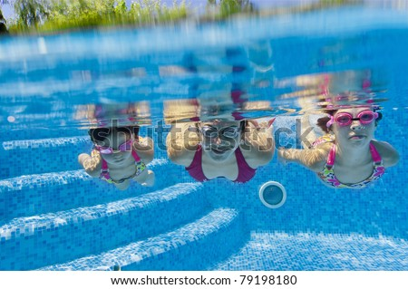 Underwater family in swimming pool