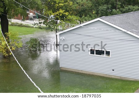 Underwater flooding in a backyard.
