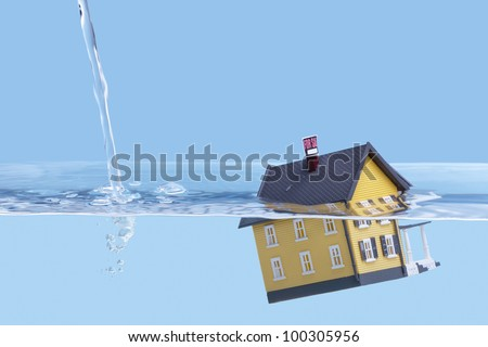 Underwater home mortgage, house for sale, real estate crisis concept, copy space stock photo