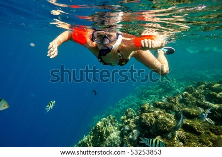 underwater image of young woman snorkeling