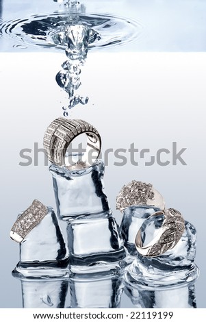 Underwater Jewelery. A view of jewelery being dropped on ice cubes underwater.