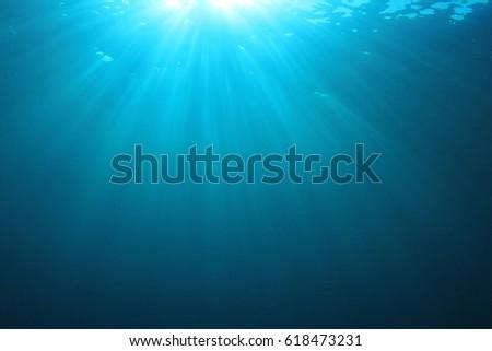Underwater ocean background and sun #618473231