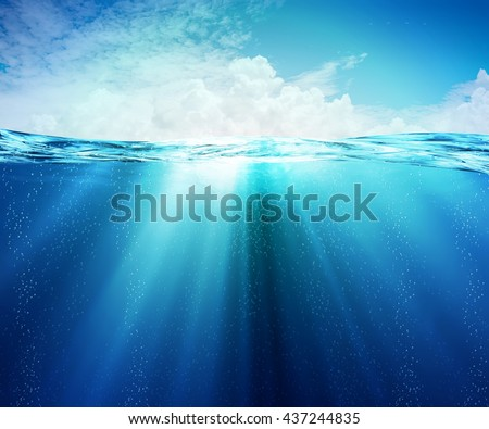 Underwater or under the sea Beauty turquoise sea, In view of the sky bright atmosphere with some clouds. #437244835