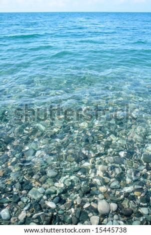 Underwater pebble texture skyline.