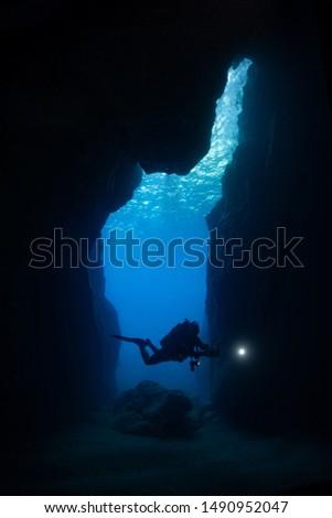 underwater photographer in underwater cave