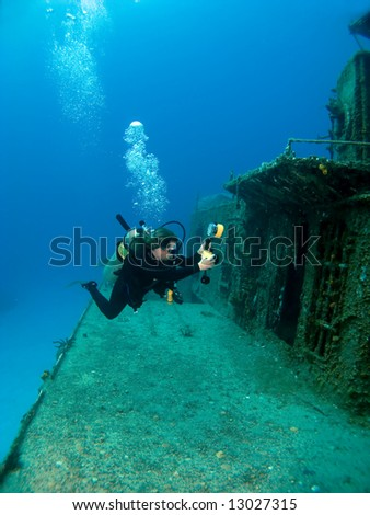 Underwater Photographer shooting a Sunken Ship in Cayman  Brac