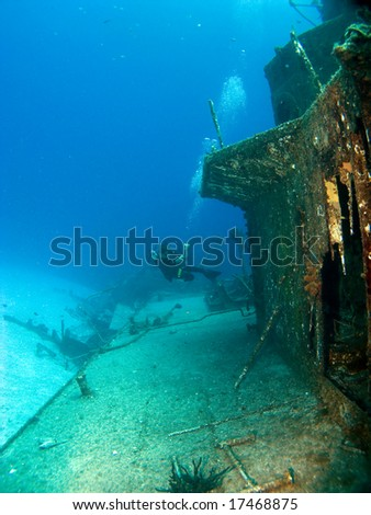 Underwater Photographer Shooting a Sunken Ship in Cayman Brac