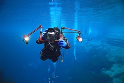 underwater photographer with a camera, diver hobby special underwater boxing with a camera