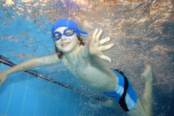 Underwater picture of a young boy swimming and playing