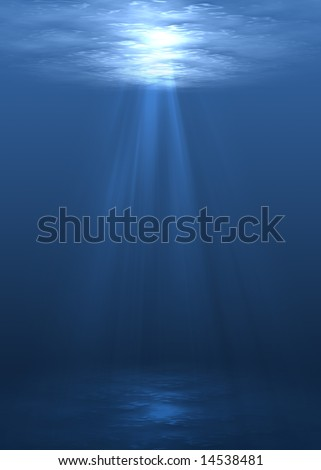 Underwater scene with sun rays shining through water surface.
