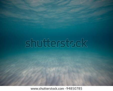 Underwater shoot of a sandy sea bottom - stock photo