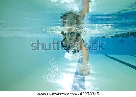 underwater shot of female competition swimmer - stock photo