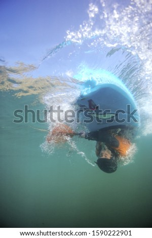 Underwater shot of person upside down in kayak