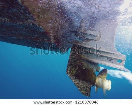 Underwater shot of running ship propeller