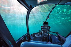Underwater submarine ship cockpit in the blue ocean with sunbeams and copy space. Undersea background. Travel concept.