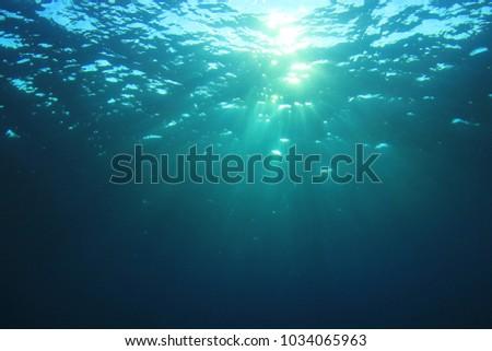 Stock Photo Underwater sunburst ocean background