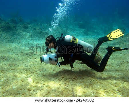 Underwater Videographer shooting on a Cayman Island Reef