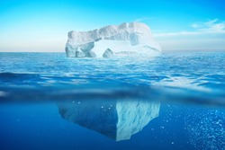 Underwater view of iceberg with beautiful transparent sea. Hidden Danger And Global Warming Concept