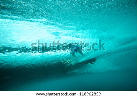 Underwater view of surfer and crystal clear wave