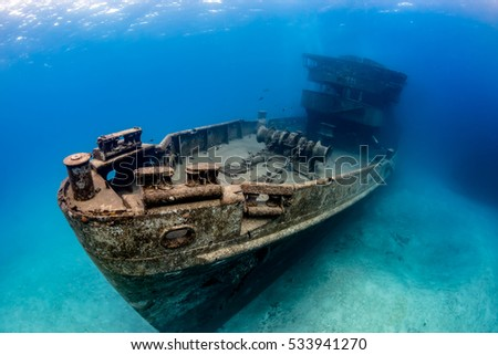 Underwater Wreck of the USS Kittiwake  - a large artificial reef in the Caribbean #533941270