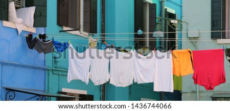 underwear briefs and underwear and clothes hanging in the typical small village of Europe #1436744066