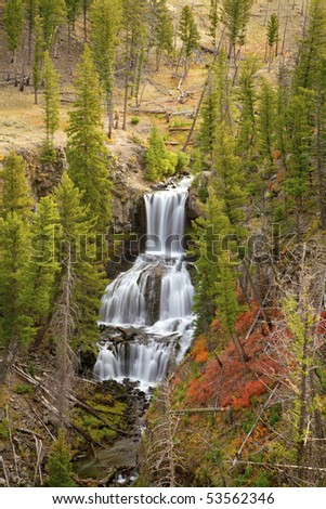 Undine Falls surrounded by fall colors, Yellowstone National Park, Wyoming, United States.