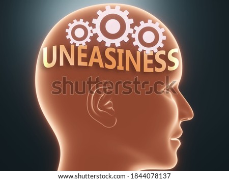 Uneasiness inside human mind - pictured as word Uneasiness inside a head with cogwheels to symbolize that Uneasiness is what people may think about and that it affects their behavior, 3d illustration Stock photo ©