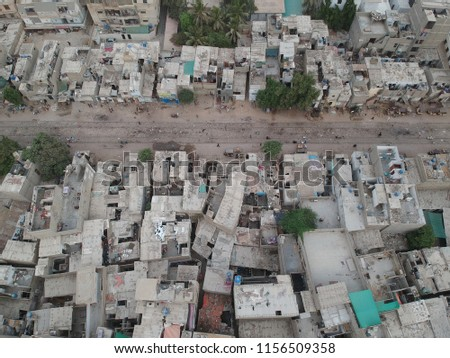 unedited drone photo of the rural are of karachi but the houses look so beautiful from the sky and the place in between is the railway track this can be used as a  wallpaper as well as an intro video #1156509358