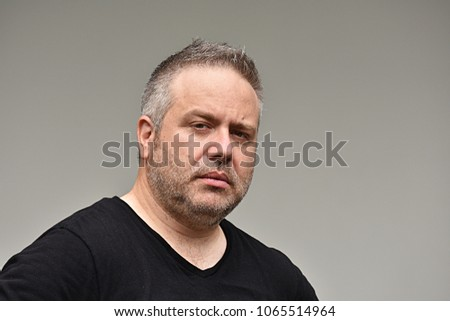 Unemotional Caucasian Man #1065514964