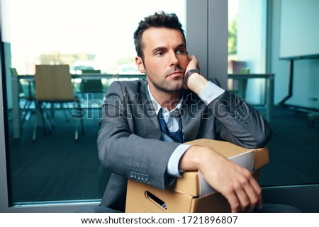 Unemployed fired from job businessman sitting at office floor thinking about his future ストックフォト ©