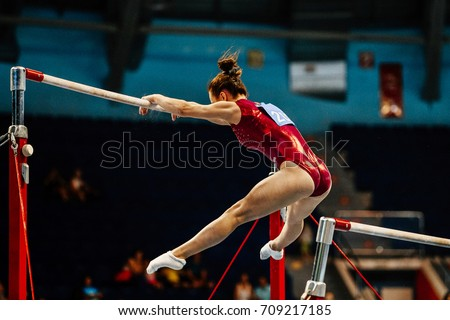 uneven bars female gymnast to competition in artistic gymnastics