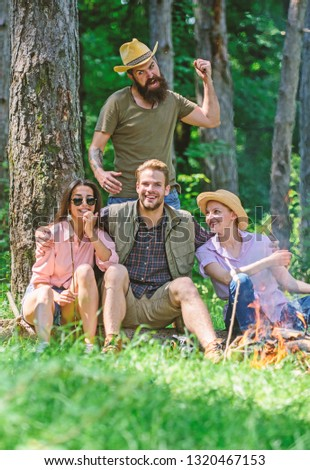 Unexpectable danger. Man brutal thief holds knife going attack hikers in forest. Friends relaxing and not expect to be attacked. Be careful. Company friends in dangerous situation in nature.