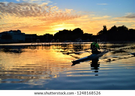 Unexpected photograph of kayaker while I was trying to take a picture of a beautiful sunset. Spontaneous and thrilling moments in Galway, Ireland.