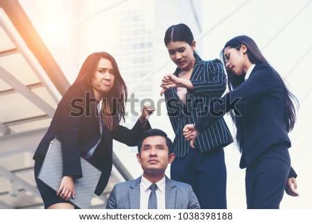 Unfavorable friends at office. Business people not satisfied. Women gestures unwelcome businessman.