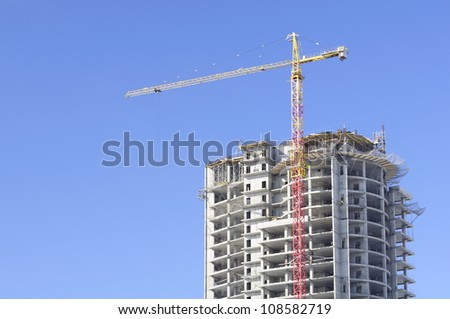 Unfinished Building and Lift Crane on Construction Site