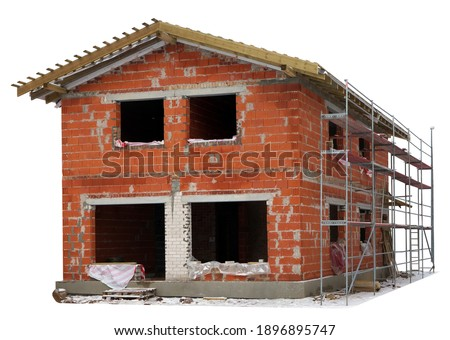 Unfinished building of a red brick rural house in the winter. Isolated on white. Mass production Stock photo ©