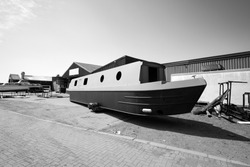 Unfinished canal barge in a boatyard