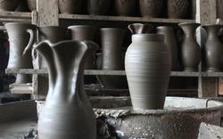 Unfinished ceramic vase on wheel in pottery workshop