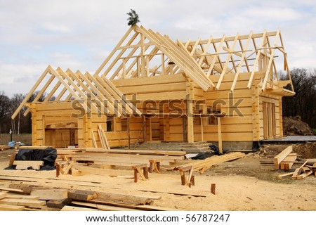 Unfinished, ecological wooden house and building area