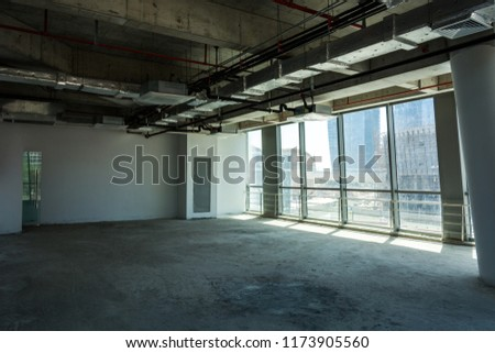 Unfinished interior of business center under construction in grey colours #1173905560