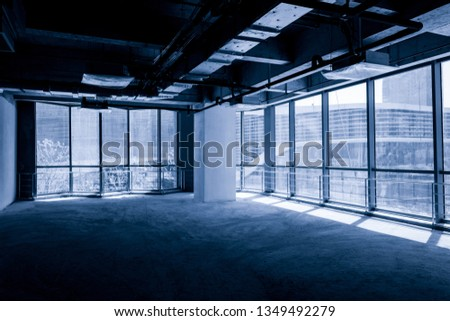 Unfinished interior of business center under construction in grey colours #1349492279