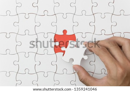 unfinished jigsaw puzzle texture on red background. connection concept. idea concept.association concept