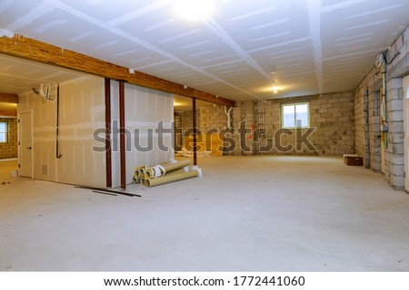 Unfinished new build interior construction basement renovation ground floor Inside selected focus Foto stock ©