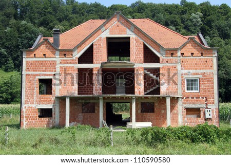 Unfinished red brick house in Croatia - stock photo