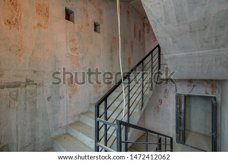 unfinished staircase to basement. Stairs architecture unfinished at basement. Cement concrete staircase on construction site. Building with Materials and Structure Exposed. entrance to house #1472412062