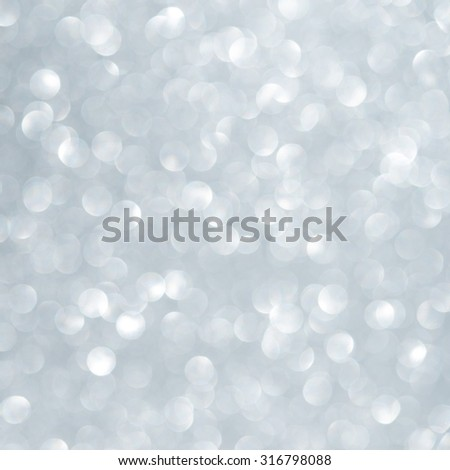 Unfocused abstract light blue glitter holiday background. Winter xmas holidays.